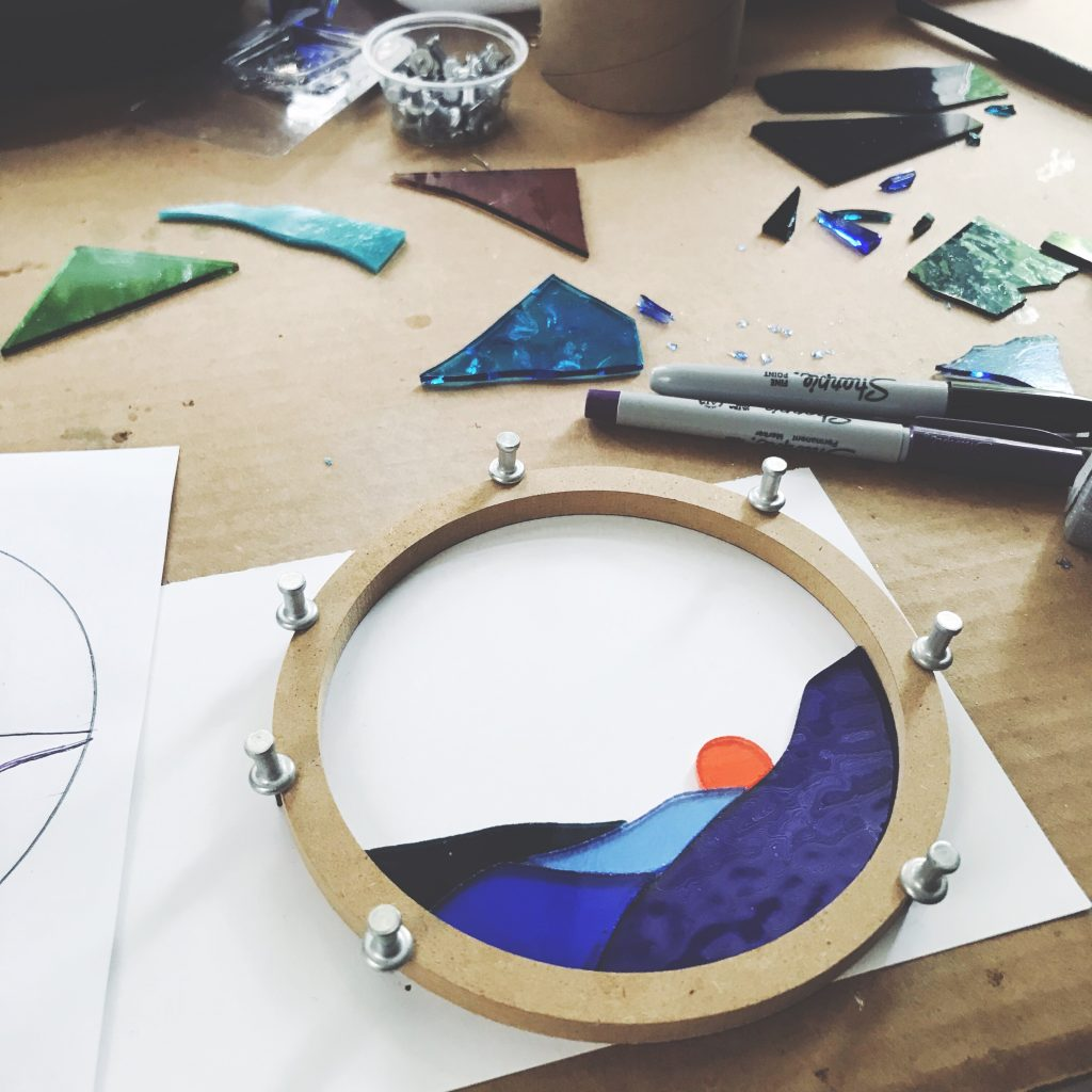Round panel stained glass creation in the studio // photo by Meghan Tutolo of 1flychicken creations